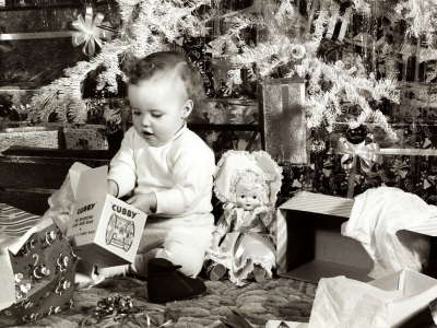 Baby is opening the gifts