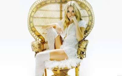 Sienna Miller on chair