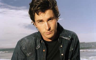 Christian Bale In Jean Jacket On Beach