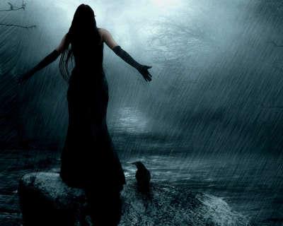 Woman on Stormy Beach