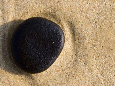 Black Pebble Sandy Beach