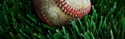 Dirty Baseball On Grass