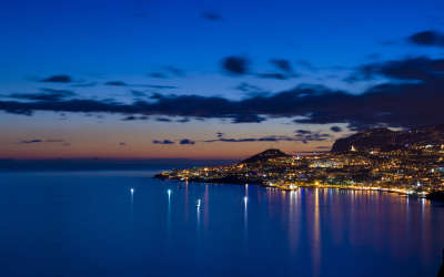 Sea And City At Night