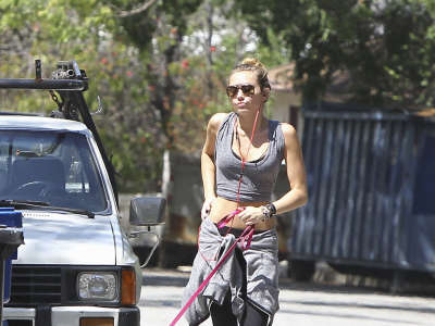 Miley Cyrus Jogging With Her Dog